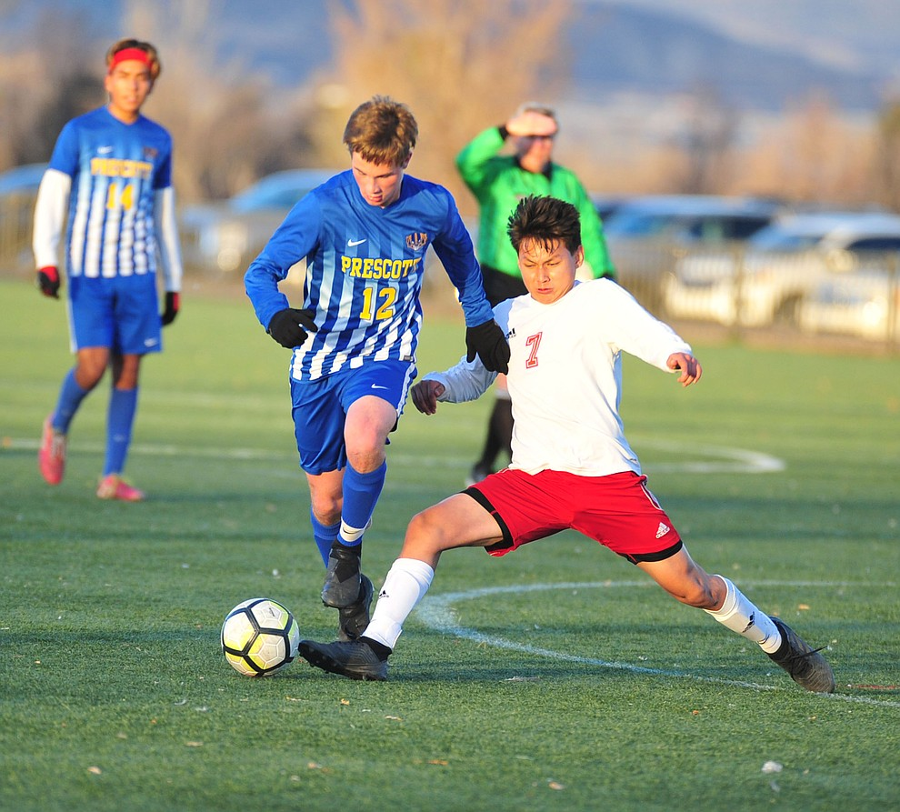 Prescott's Brayden Nelson moves the ball around  Angel De La Cruz enroute to a first half goal as the Badgers take on the Mingus Marauders Wednesday Jan. 16, 2019 in Prescott Valley. (Les Stukenberg/Courier).