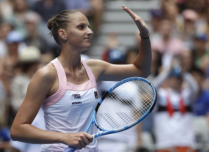 Karolina Pliskova of the Czech Republic waves after defeating United States' Madison Brengle in their second round match at the Australian Open tennis championships in Melbourne, Australia, Thursday, Jan. 17, 2019. (Mark Schiefelbein/AP)