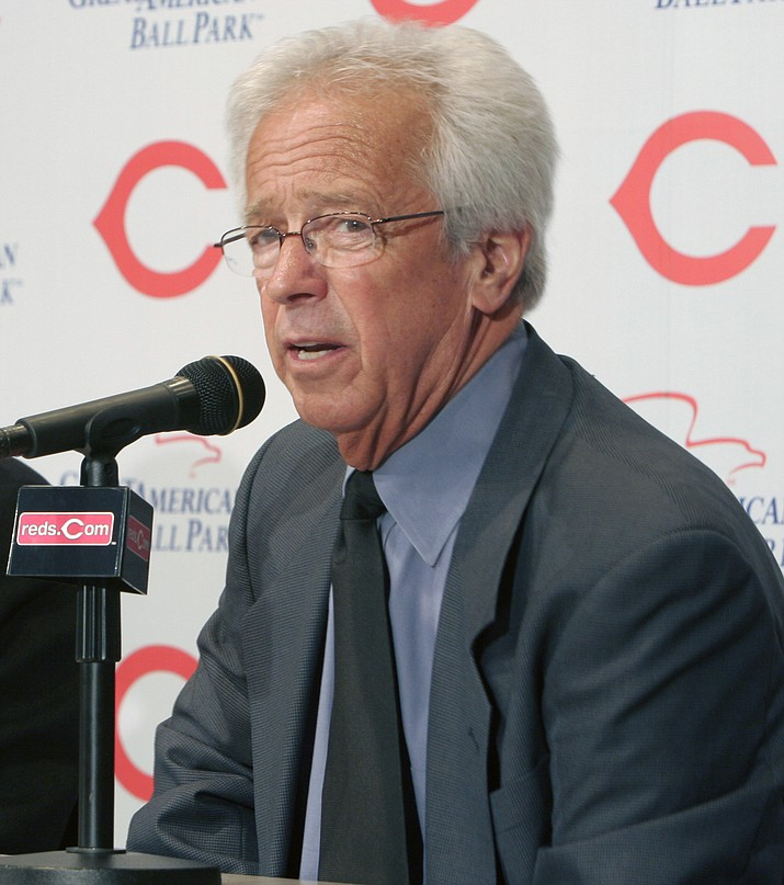 "In this April 2, 2007, file photo, Cincinnati Reds radio broadcaster Marty Brennaman answer questions at a news conference prior to a baseball game against the Chicago Cubs, in Cincinnati. Reds play-by-play broadcaster Marty Brennaman will retire after the 2019 season, his 46th in Cincinnati. The team made the announcement Wednesday, Jan. 16, 2019. The 76-year-old Brennaman joined the Reds' radio team in 1974 and soon became known for his sign-off line after each win: ""And this one belongs to the Reds."" He and former Reds pitcher Joe Nuxhall shared the booth for 31 seasons from 1974-2004.(David Kohl/AP, file)"