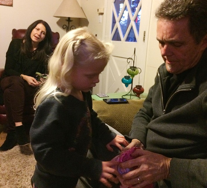 Sebellah, middle, comes up to her grandfather Richard Young while her grandmother, Allene Young, looks on Wednesday, Jan. 16, 2019. (Nanci Hutson/Courier)
