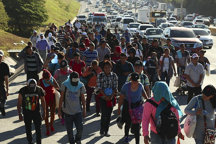 Migrants traveling in a group begin their journey toward the U.S. border as they walk along a highway in San Salvador, El Salvador, early Wednesday, Jan. 16, 2019. Migrants fleeing Central America's Northern Triangle region comprising Honduras, El Salvador and Guatemala routinely cite poverty and rampant gang violence as their motivation for leaving. (Salvador Melendez/AP)