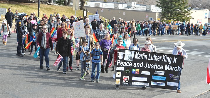 A crowd estimated, by the Prescott Police Department, at 450 people march in the 2018 Martin Luther King Jr. Peace and Justice March through downtown Prescott. (Les Stukenberg/Courier, file)