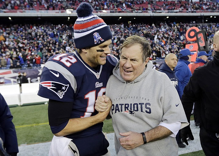 In this Dec. 14, 2014, file photo, New England Patriots quarterback Tom Brady, left, celebrates with head coach Bill Belichick after defeating the Miami Dolphins 41-13 in an NFL football game in Foxborough, Mass. The Patriots have dominated the AFC for nearly two decades _ if not the entire NFL _ and the coach-quarterback combination of Bill Belichick and Tom Brady will be playing in their eighth conference title game Sunday when New England visits the Chiefs at frigid, hostile Arrowhead Stadium.  (Charles Krupa/AP, file)