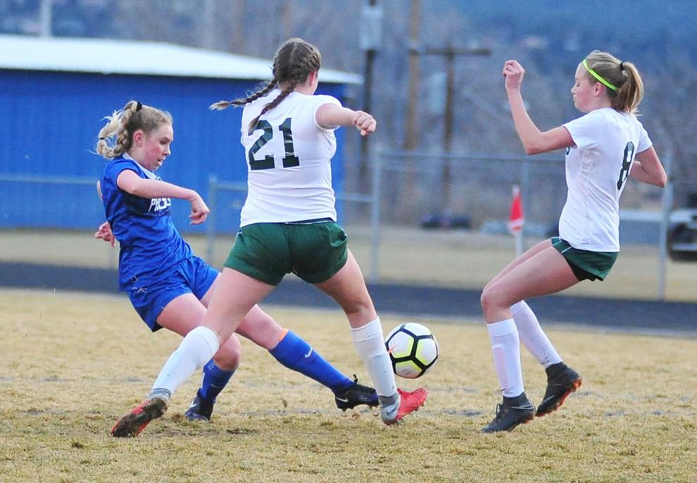 Prescott's Ellie Magnett sends the ball between a pair of defenders as the Badgers take on the Flagstaff Eagles Thursday Jan. 17, 2019 in Prescott. (Les Stukenberg/Courier).