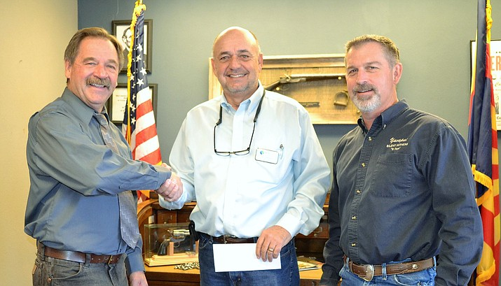 Sheriff Mascher accepts check from Bob Beyea of BloomTree Realty on behalf of Yavapai Silent Witness Director Chris Wilson. (Yavapai County Sheriff's Office/Courtesy)