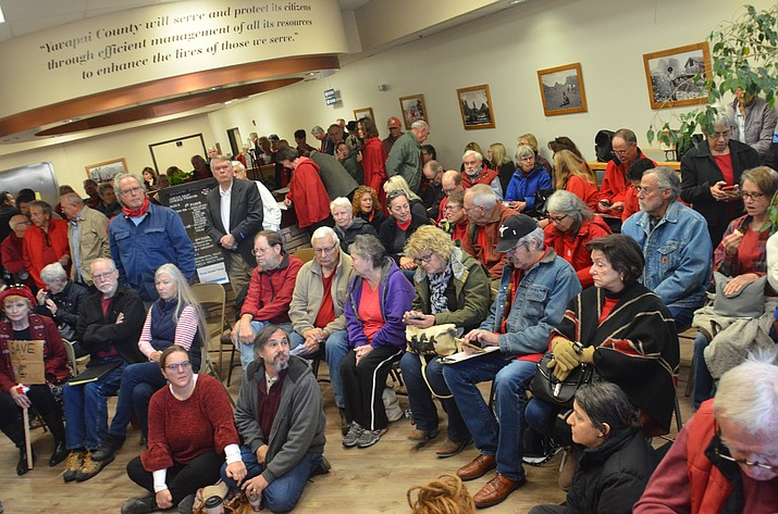 An estimated 300 people showed up to the Yavapai County Planning & Zoning meeting Thursday. Many of them had been at the meeting chambers since 9 a.m. Crowds overflowed into the lobby with additional overflow upstairs. They wore red and held signs protesting the Rojo Grande development. VVN/Vyto Starinskas