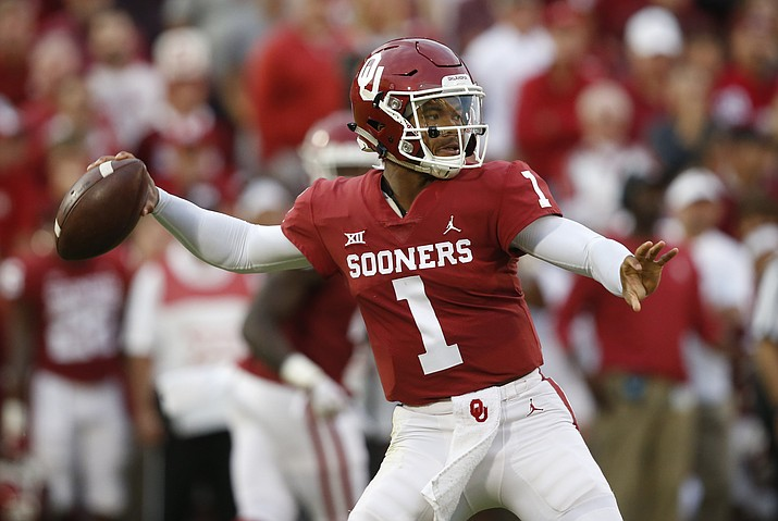 In this Sept. 22, 2018, file photo, Oklahoma quarterback Kyler Murray (1) throws in the first half of an NCAA college football game against Army, in Norman, Okla. Kyler Murray, the first-round Major League Baseball draft pick and Heisman Trophy-winning Oklahoma quarterback, says he is declaring himself eligible for the NFL draft. Murray announced his decision Monday, Jan. 14, 2019, in a tweet. (Sue Ogrocki/AP, file)