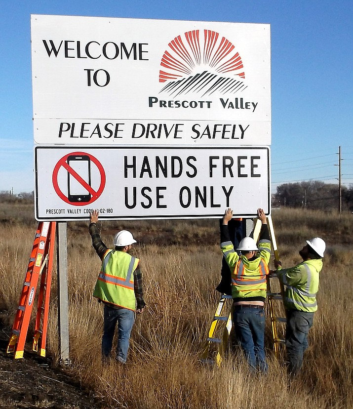 Prescott Valley Public Works crews on Thursday placed signs throughout the Town of Prescott Valley to remind drivers of the new ban on use of handheld devices while driving. The ban is now county-wide. Arizona Department of Transportation assisted the Town in obtaining permits to place the signs in public right of way. (Town of Prescott Valley)