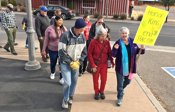 """Michele Herrick, far right holding yellow sign, said that Dr. Martin Luther King Jr. was """"more than a hero"""" to her. """"To seehow important Dr. Martin Luther King Jr. was to so many andthat admiration in Chandler has been very heartwarming to me."""" VVN/Bill Helm"""