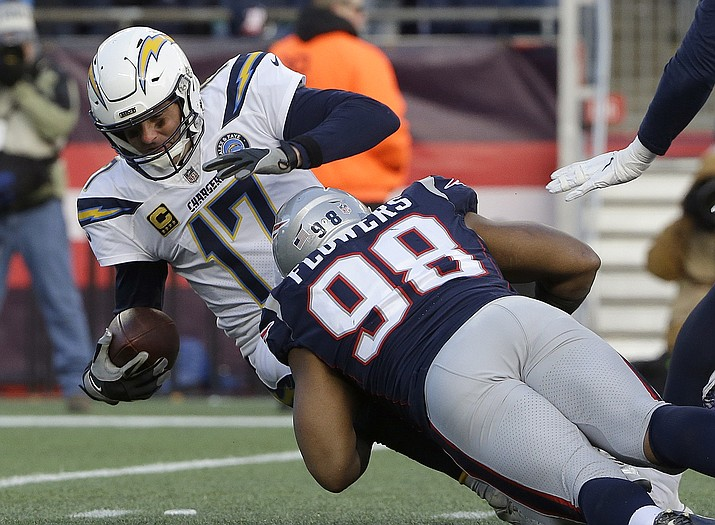 New England Patriots defensive end Trey Flowers (98) sacks Los Angeles Chargers quarterback Philip Rivers during the second half of an NFL divisional playoff football game, Sunday, Jan. 13, 2019, in Foxborough, Mass. (Steven Senne/AP)