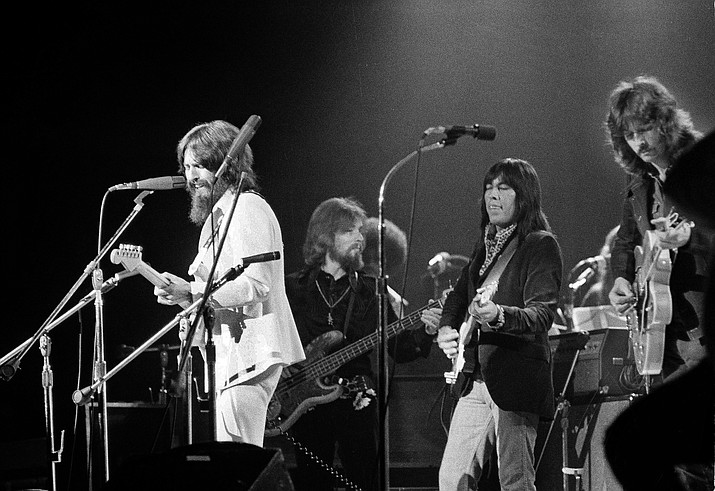 "In this Aug. 1, 1971 file photo, Jesse Ed Davis, center right, a guitarist of Kiowa and Comanche ancestry, performs with George Harrison, left, formerly of the Beatles, at the Concert For Bangladesh at Madison Square Garden in New York City. Klaus Voorman is on bass, second from left, and Eric Clapton is at right. ""RUMBLE: The Indians Who Rocked the World,"" a new PBS Independent Lens documentary set to air Monday, Jan 21, 2019, shows how Native Americans laid the foundations to rock, blues and jazz. (Jim Wells/AP, File)"