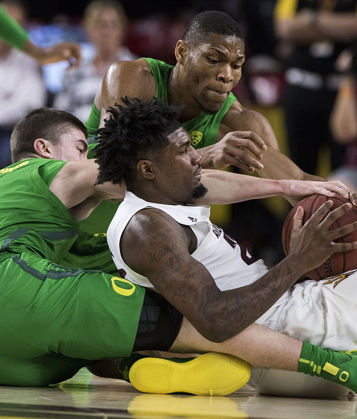 Arizona State's Romello White (23) controls the ball as he battles against Oregon's Payton Pritchard (3) and Francis Okoro (33) during the first half of an NCAA college basketball game Saturday, Jan. 19, 2019, in Tempe. (Darryl Webb/AP)