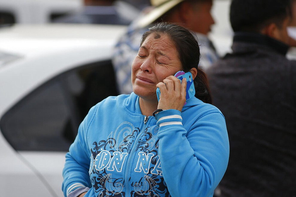 A woman cries outside a funeral service in Tula, Hidalgo state, Mexico, Saturday, Jan. 19, 2019. A massive fireball that engulfed people scooping up fuel spilling from a pipeline ruptured by thieves in central Mexico killed multiple people and badly burned others. (AP Photo/Claudio Cruz)