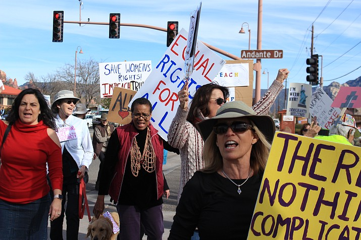 Swaths of marchers from all over the Verde Valley march toward Vino Di Sedona on Saturday, Jan. 19 during the third annual Sedona Women's March. VVN/Kelcie Grega