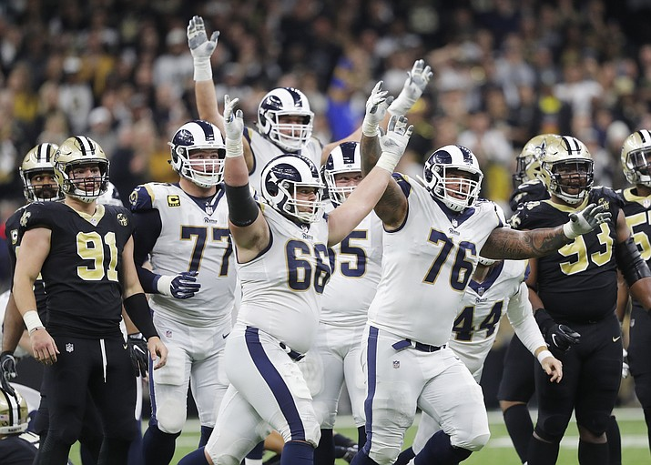 Los Angeles Rams players celebrate after overtime of the NFL football NFC championship game against the New Orleans Saints, Sunday, Jan. 20, 2019, in New Orleans. The Rams won 26-23. (Gerald Herbert/AP)