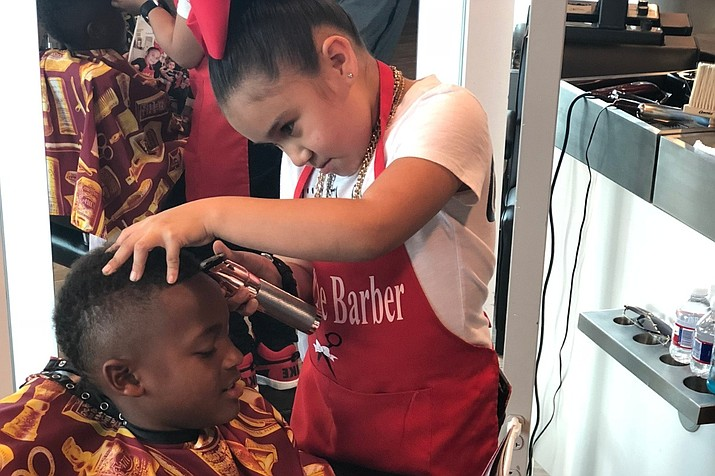 Alijah Hernandez, 7, is a skilled barber in training. Her family is raising money so she can compete in state and national barber competitions. (Photo: GoFundMe)