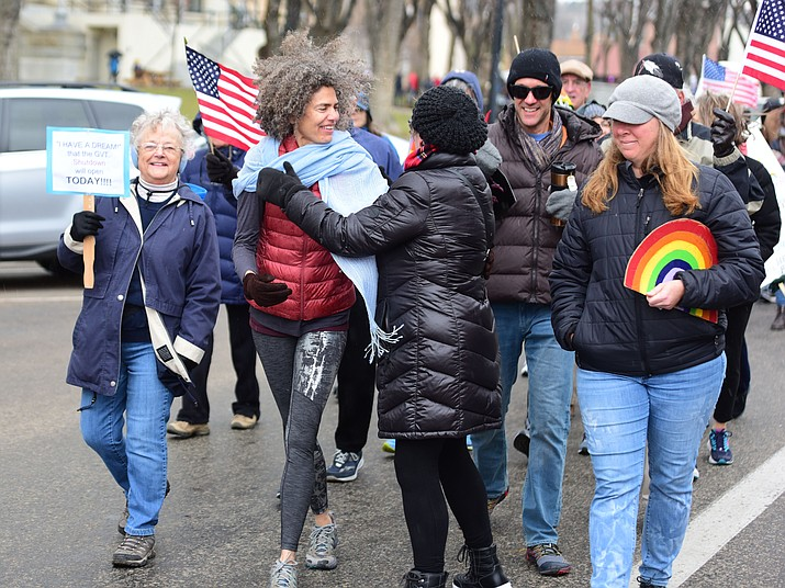 Several hundred people, young, old, male, female and of different racial backgrounds braved the cold, freezing rain and wind to march in the annual Martin Luther King Jr. Peace and Justice march through the downtown area Monday Jan. 21, 2019 in Prescott.  The march started at Prescott College down Gurley Street and around the Yavapai County Courthouse Plaza and returned to Prescott College. (Les Stukenberg/Courier)