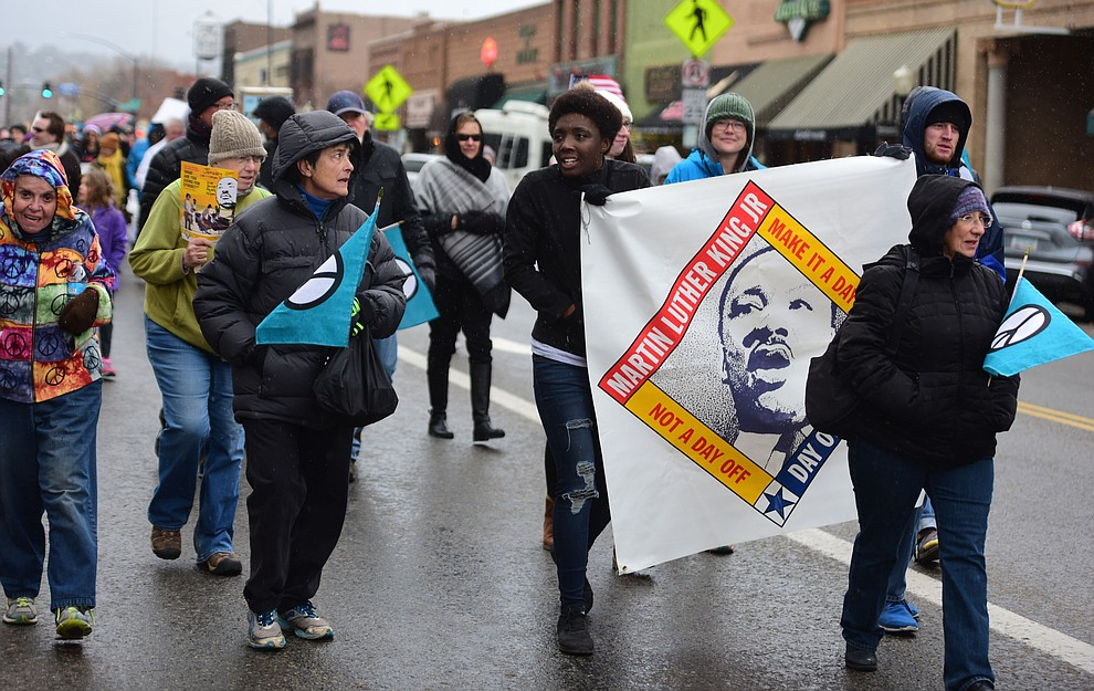 Several hundred people, young, old, male, female and of different racial backgrounds braved the cold, freezing rain and wind to march in the annual Martin Luther King Jr. Peace and Justice march through the downtown area Monday Jan. 21, 2019 in Prescott. .The march started at Prescott College down Gurley Street and around the Yavapai County Courthouse Plaza and returned to Prescott College. (Les Stukenberg/Courier).