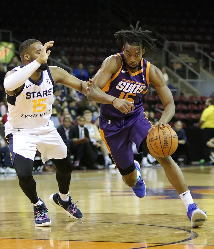 Trayvon Palmer of the Northern Arizona Suns drives the ball against Deonte Burton of the Salt Lake City Stars during a game on Tuesday, Jan. 22, 2019, in Prescott Valley. (Matt Hinshaw/NAZ Suns)