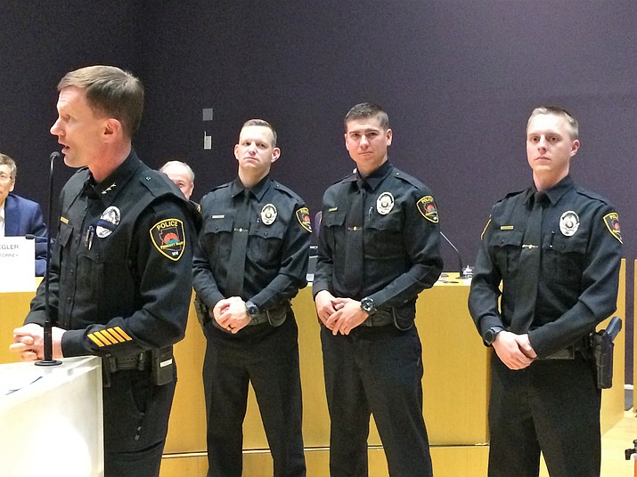 Prescott Valley Deputy Police Chief James Edelstein, left, introduces the three newest members of the PVPD to the Prescott Valley Town Council Jan. 10. From left are Cody Skvarek, Garrett Rozendaal and Ryan Heggestad. (Sue Tone/Tribune)