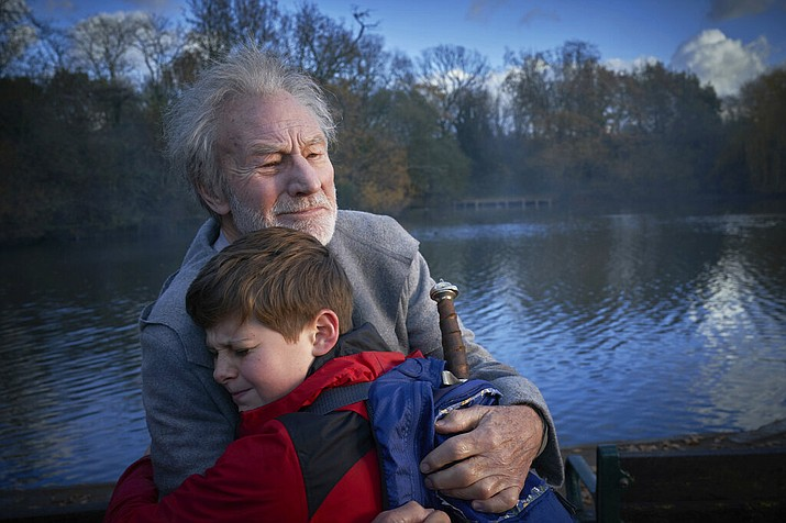 """This image released by 20th Century Fox shows Patrick Stewart and Louis Ashbourne Serkis in a scene from """"The Kid Who Would Be King."""" (Kerry Brown/20th Century Fox via AP)"""