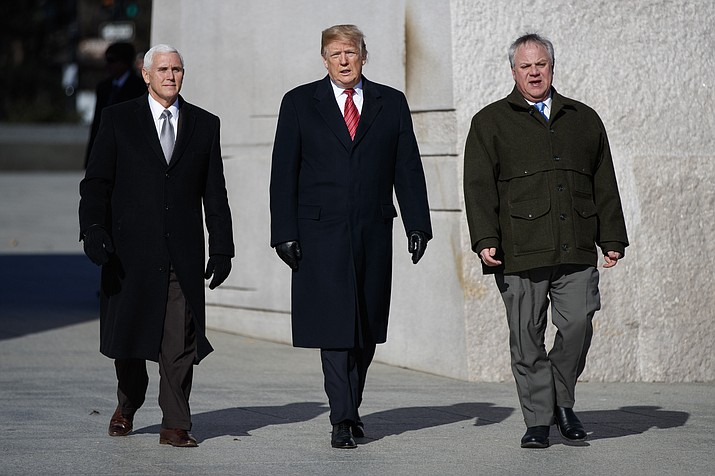 President Donald Trump, center, Vice President Mike Pence, left, escorted by Acting Interior Secretary David Bernhardt, right, visit the Martin Luther King Jr. Memorial, Monday, Jan. 21, 2019, in Washington. (Evan Vucci/AP)