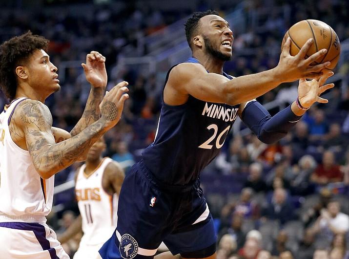 Minnesota Timberwolves guard Josh Okogie (20) drives to the basket as Phoenix Suns forward Kelly Oubre Jr. defends during the first half of an NBA basketball game, Tuesday, Jan. 22, 2019, in Phoenix. (Matt York/AP)