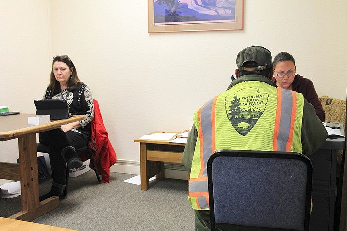 Federal employees met with caseworkers from Coconino County Community Services to receive electric bill assistance from APS Jan. 16. (Loretta Yerian/WGCN)