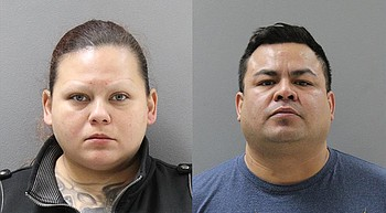 2 suspects arrested after 12 pounds of heroin found in trunk of car photo