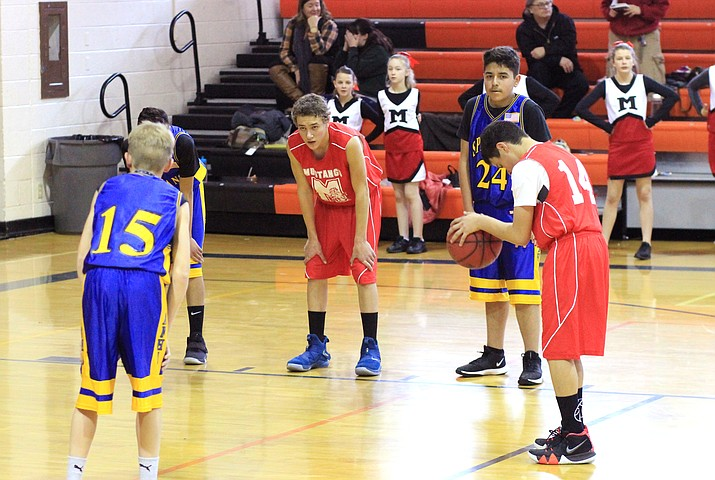 Ash Fork Middle School and Maine Consolidated School play a game in Williams for the first weekend of I-40 League basketball Jan. 18.