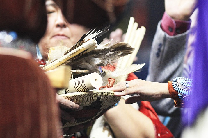 Members of the 24th Navajo Nation Council extend their hands as the oath of office is administered during the Navajo Nation inauguration Jan. 15 at Bee Holdzil Fighting Scouts Events Center in Fort Defiance, Arizona. (Loretta Yerian/NHO)