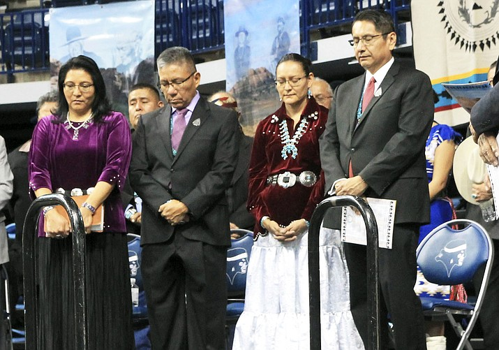 From left: Dottie Lizer, Vice President Myron Lizer, First Lady Phefelia Herbert Nez and Navajo Nation President Jonathan Nez bow their heads for prayer during inauguration ceremonies at Bee Holdzil Fighting Scouts Events Center in Fort Defiance, Arizona Jan. 15. (Loretta Yerian/NHO)