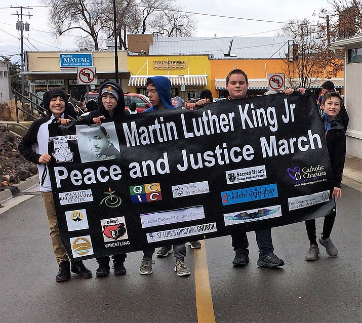 Members of the Bradshaw Mountain Middle School wrestling team carry the Martin Luther King, Jr., banner to the conclusion of the March, Jan. 21, at the Prescott United Methodist Church (Sue Tone/Courier)