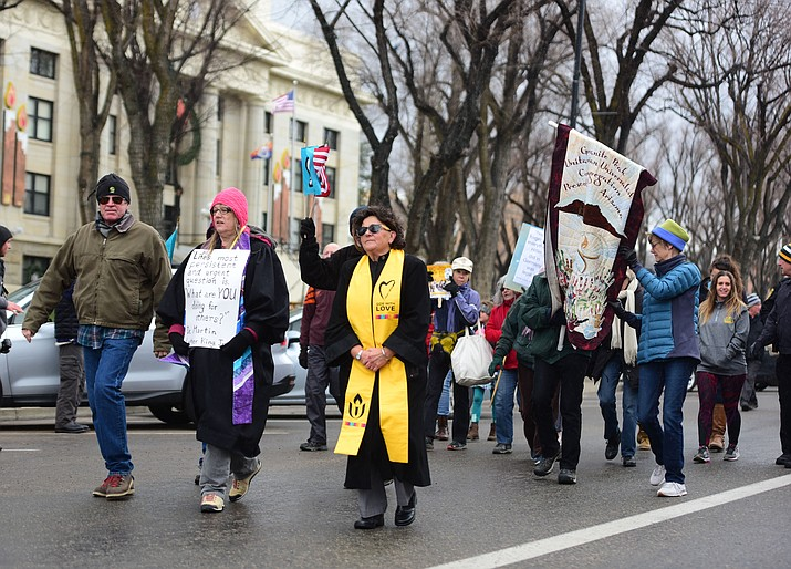 Several hundred people — young, old, men, women and of different racial backgrounds — braved the cold, freezing rain and wind to march in the annual Martin Luther King Jr. Peace and Justice March through downtown Prescott Monday Jan. 21, 2019. The march started at Prescott College, proceeded down Gurley Street and around the Yavapai County Courthouse Plaza and returned to Prescott College. To view a photo gallery, visit dCourier.com. (Les Stukenberg/Review)
