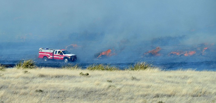 The Prescott Valley Fire burns north of Highway 89A through the grasslands between Prescott and Prescott Valley on Monday, Jan. 21. 2019. By 4 p.m. Monday the fire, which burned 459 acres, was under control. Firefighters, however, were still putting out hotspots Tuesday, Jan. 22. (Les Stukenberg/Courier)