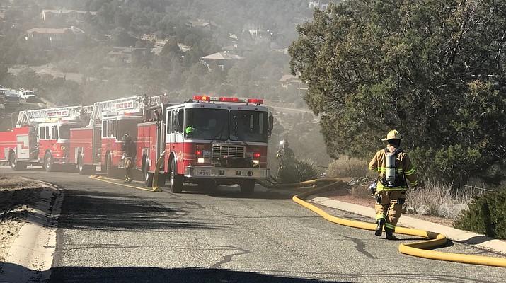 Firefighters battling home fire in Prescott
