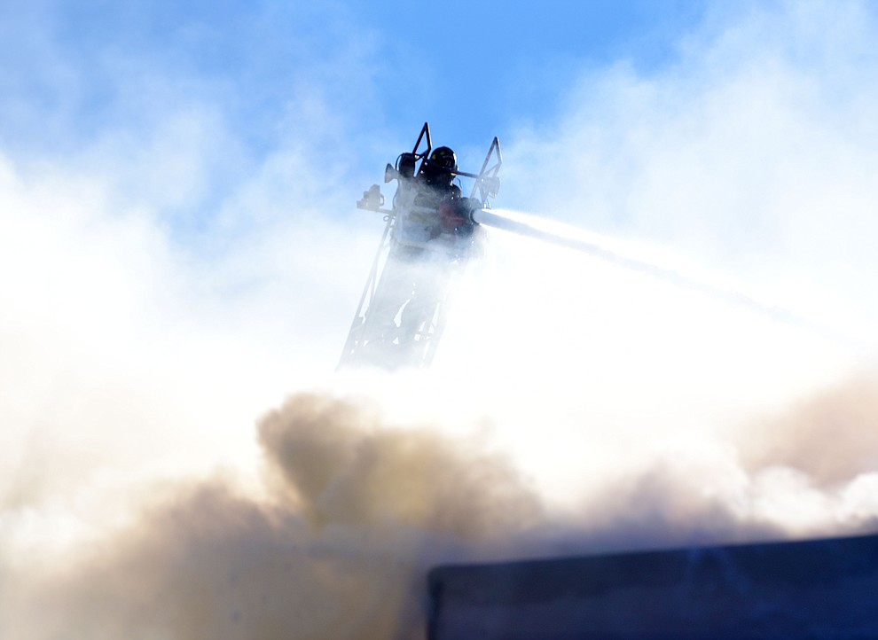 Prescott and Central Arizona and Chino Valley firefighters responded to a three-alarm structure fire in the 3000 block of Rainbow Ridge in the Ranch subdivision of Prescott Tuesday, Jan. 22, 2019. (Les Stukenberg/Courier).