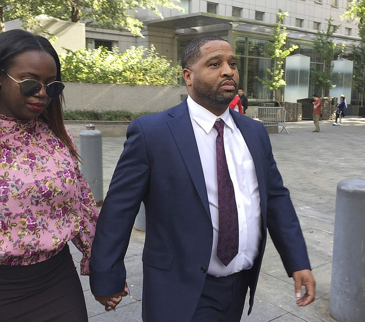 In this Oct. 10, 2017, file photo, University of Arizona assistant men's basketball coach Emanuel Richardson leaves Manhattan federal court in New York. Richardson, no longer with the team, is expected in federal court, Tuesday, Jan. 22, 2019, for a development in a criminal case in which he is charged with taking bribes from a sports agent. (Larry Neumeister/AP, file)