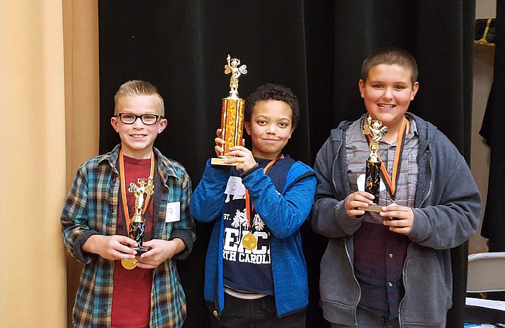 Williams Elementary-Middle School will be sending Brody MacKinnon (third place), Iscariot Rushing (first place) and Alex Loeslein (second place) to the Coconino County Spelling Bee. (photo/WEMS)