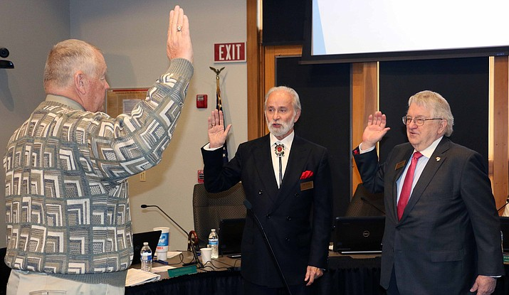 Yavapai College School Superintendent Tim Carter swears in Paul Chevalier, representing District 3 (which includes Sedona); and returning member Ray Sigafoos, who represents District 1 (including Prescott.) Courtesy photo