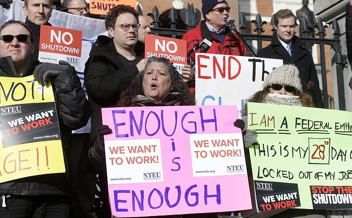 Federal employees and supporters rally Jan. 17 in front of the Statehouse, in Boston, to call for an end of the partial shutdown of the federal government. (AP Photo/Steven Senne)