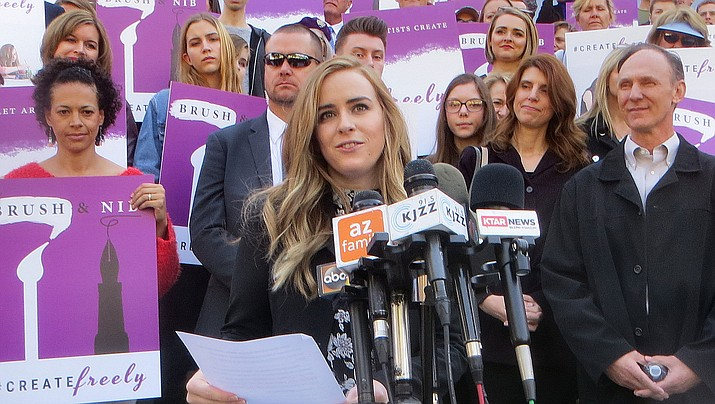 Breanna Koski explains after a Supreme Court hearing Tuesday why she and busiess partner Joanna Duka want legal protection for refusing to produce custom wedding materials for same-sex couples. (Capitol Media Services photo by Howard Fischer)