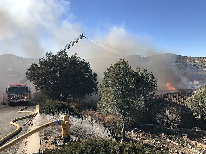 Firefighters battle a home fire in the 3100 block of Rainbow Ridge Dr. in Prescott Tuesday afternoon, Jan. 22.