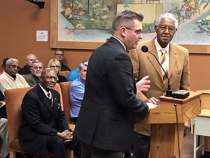 Prescott Mayor Greg Mengarelli, left, introduces Mel Hannah, chairman of the Arizona Commission of African American Affairs, during a presentation to the Prescott City Council Tuesday, Jan. 22. Hannah and Arizona NAACP President Charles Fanniel read letters of support for the council's December stand against racial comments made by Prescott State Legislator David Stringer. (Cindy Barks/Courier)