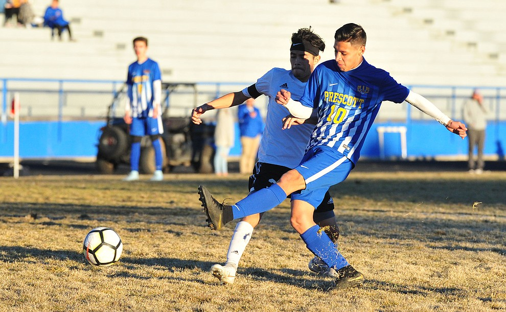 Prescott's Edgar Martinez takes a shot on goal as the Badgers take on the Coconino Panthers Wednesday, Jan. 23, 2019 in Prescott. (Les Stukenberg/Courier).