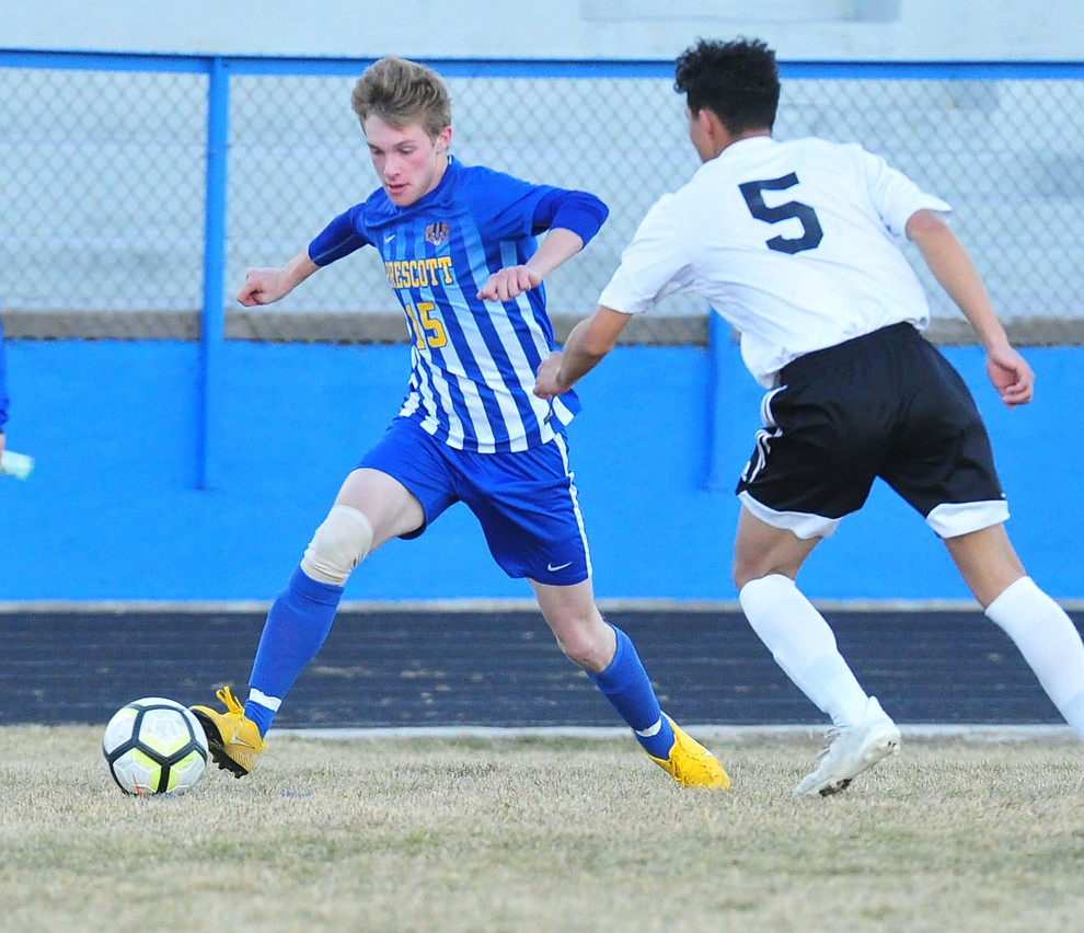 Prescott's Spencer Hewitt controls the ball in the corner as the Badgers take on the Coconino Panthers Wednesday, Jan. 23, 2019 in Prescott. (Les Stukenberg/Courier).