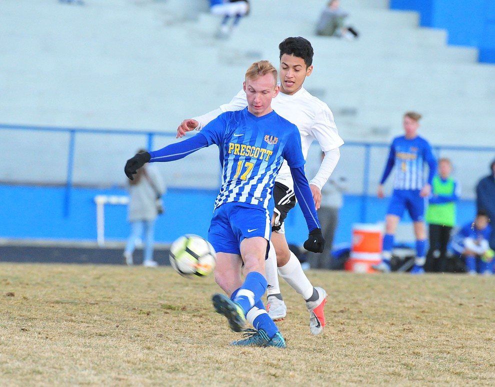 Prescott's Ryan Doyle takes a shot on goal as the Badgers take on the Coconino Panthers Wednesday, Jan. 23, 2019 in Prescott. (Les Stukenberg/Courier).