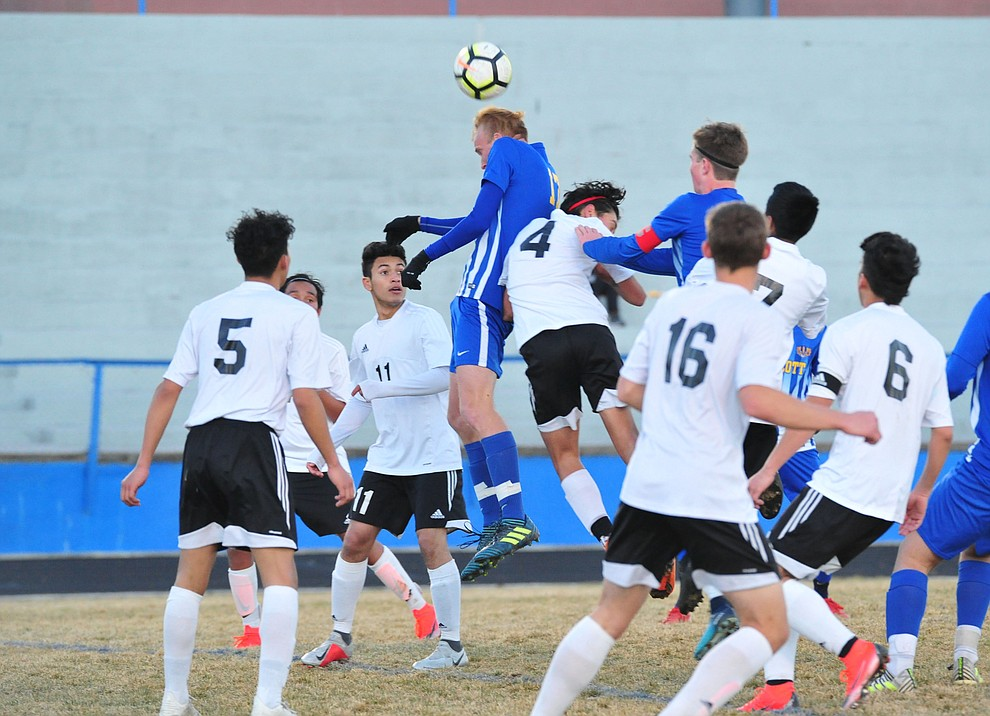 Prescott's Ryan Doyle heads the ball off a corner kick as the Badgers take on the Coconino Panthers Wednesday, Jan. 23, 2019 in Prescott. (Les Stukenberg/Courier).