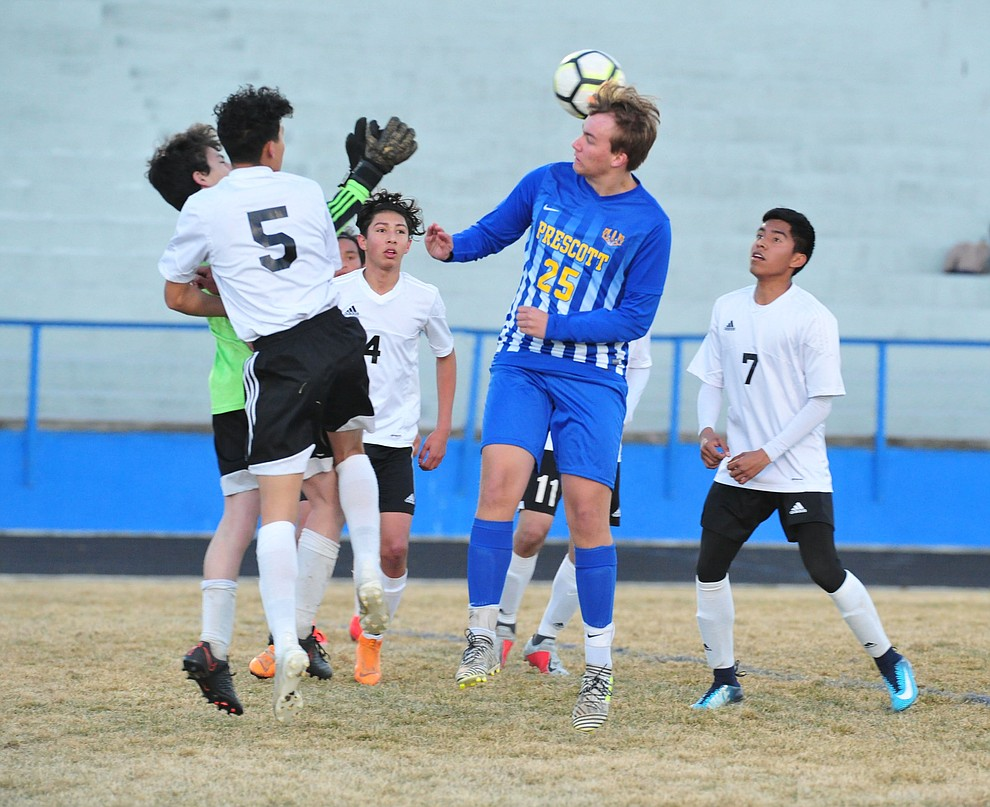 Prescott's Jack Gould heads the ball towards the goal as the Badgers take on the Coconino Panthers Wednesday, Jan. 23, 2019 in Prescott. (Les Stukenberg/Courier).