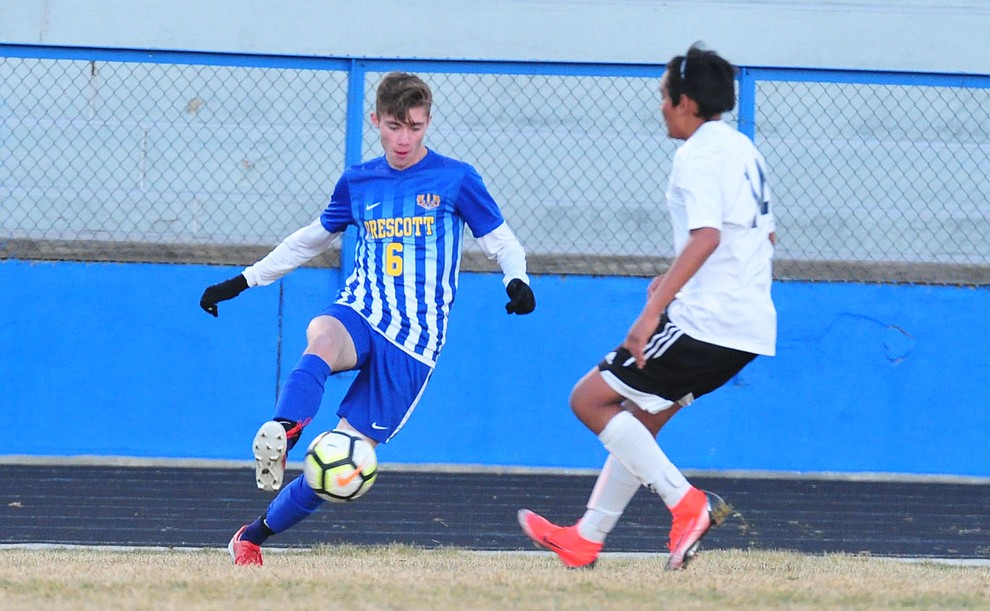 Prescott's Cade Tutrone controls the ball in the corner as the Badgers take on the Coconino Panthers Wednesday, Jan. 23, 2019 in Prescott. (Les Stukenberg/Courier).